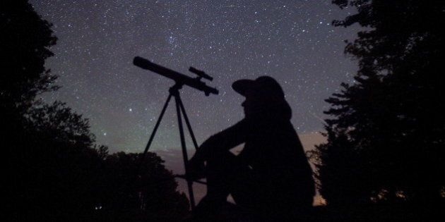 A stargazer waits for the Perseid meteor shower to begin near Bobcaygeon, Ontario, August 12, 2015. Picture...