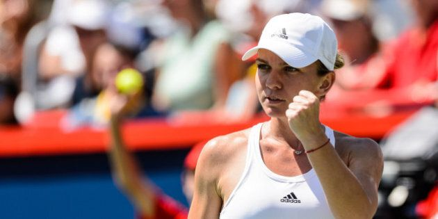 MONTREAL, ON - JULY 31: Simona Halep of Romania reacts against Madison Keys of the United States during...