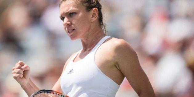 Simona Halep of Romania celebrates her 3-6, 6-1, 6-1 win over Svetlana Kuznetsova of Russia in their...