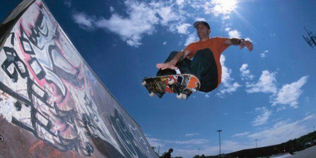 Skateboarding using ramp at skate