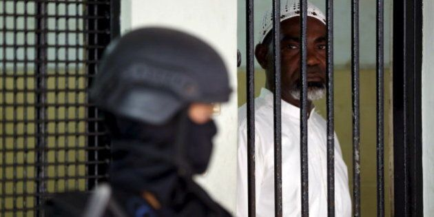 Death row drug convict Martin Anderson from Ghana waits in a holding cell before a judicial review hearing...