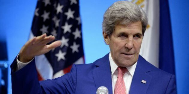 US Secretary of State John Kerry (L) gestures during a joint press conference with Philippine Foreign...