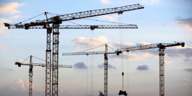 Cranes are seen at a construction site in the new neighbourhood of Carmei Gat in the southern Israeli...