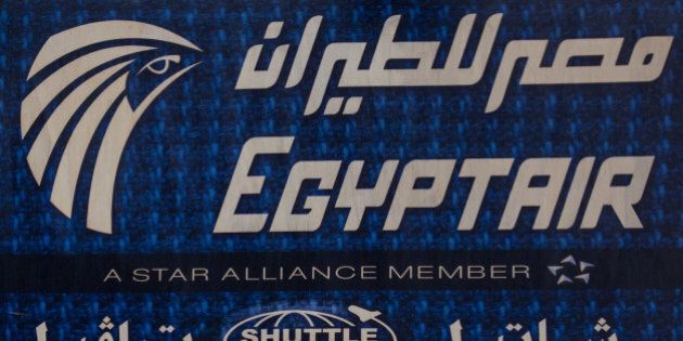 CAIRO, EGYPT - MAY 23: An advert promoting EgyptAir is seen on the outside of a travel agency on May...