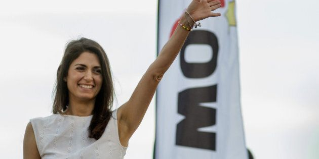 Virginia Raggi, the Five Star Movement's candidate for mayor of Rome, gestures during a campaign rally in Ostia, near Rome, Italy, on Friday, June 17, 2016. After topping the first round of local elections, Raggi could become Rome first-female mayor in a run-off on Sunday. Photographer: Alessia Pierdomenico/Bloomberg via Getty Images