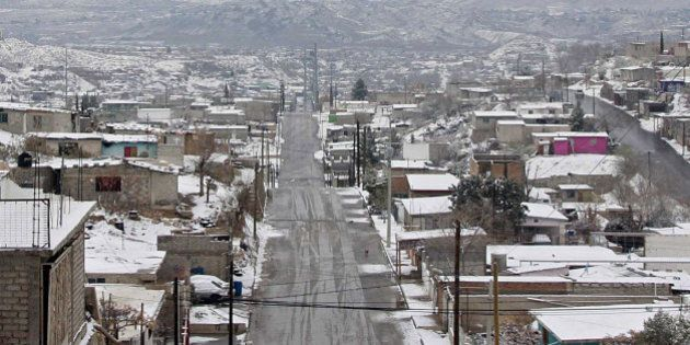 Snow covers Ciudad Juarez, Mexico, on January 3, 2013. Snow and temperatures below zero are rare in this...