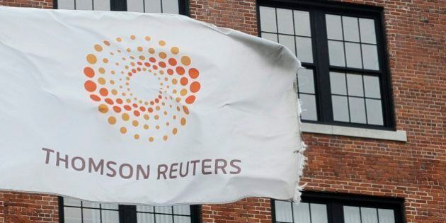 FILE-- A flag displaying the Thomson Reuters logo flies outside a company building, Monday, Aug. 11,...