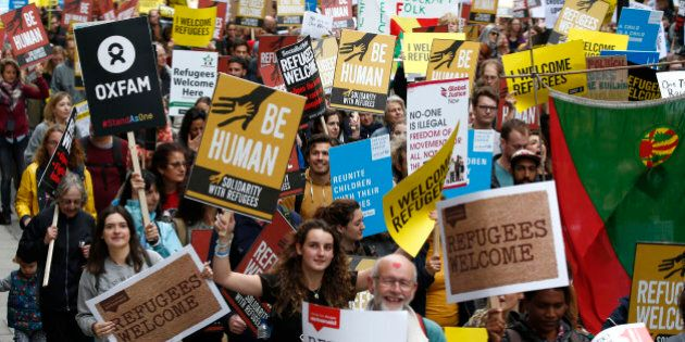 Demonstrators including refugees march to the Houses of Parliament, during an Amnesty International protest...