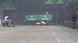 Un spectateur marche sur la piste en plein Grand Prix de Formule