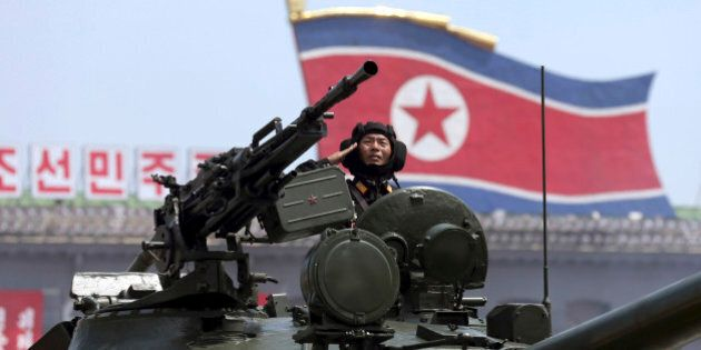 In this Saturday, July, 27, 2013, file photo, a North Korean soldier salutes while in a military tank...