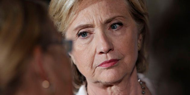 Hillary Clinton, former U.S. secretary of state and 2016 Democratic presidential candidate, listens to...