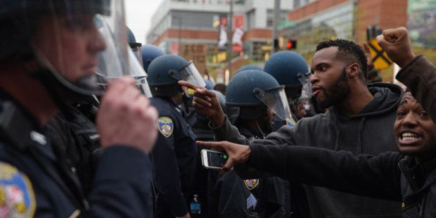 BALTIMORE, MD - APRIL 25: Protesters clash with police during a march in honor of Freddie Gray on April...
