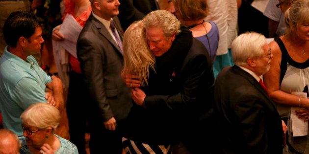 ROANOKE, VA - AUGUST 30, 2015:Andy Parker, father of Alison Parker, is comforted by a family member of...