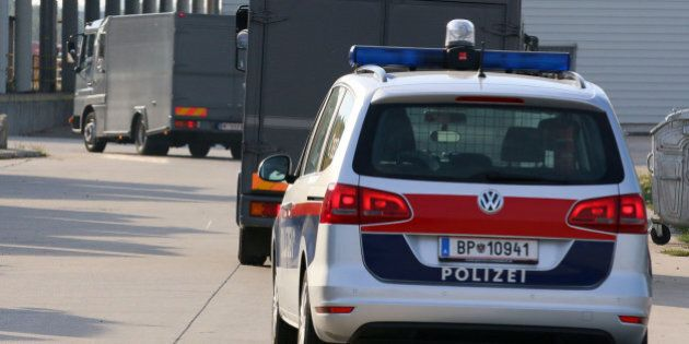 Hearses leave a veterinary border station at the Austrian/Hungarian border in Nickelsdorf, Austria, Friday,...