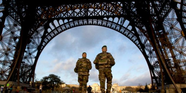 FILE - In this Sunday, Nov. 15, 2015, file photo, French soldiers patrol at the Eiffel Tower which remained...