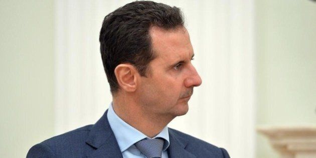 MOSCOW, RUSSIA - OCTOBER 21: Syrian President Bashar al-Assad meets with Russian President Vladimir Putin...