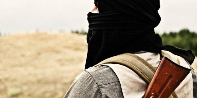 Muslim rebel with automatic rifle and machine-gun