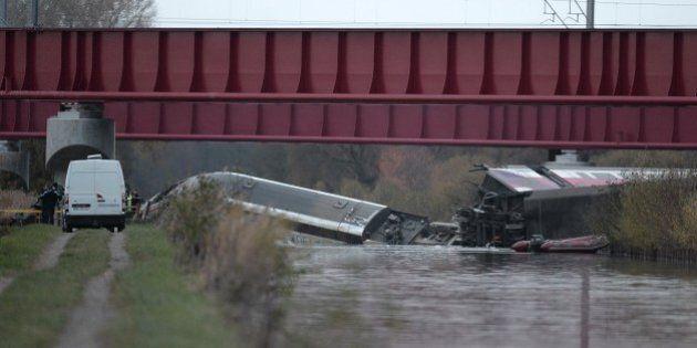 A high-speed TGV train coach and engine carriage lie in a canal in Eckwersheim near Strasbourg, northeastern...