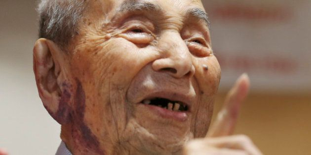 Yasutaro Koide, the 112-year-old living in the central Japanese city of Nagoya, smiles upon being formally...