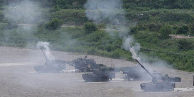 U.S. Army self-propelled howitzers fire during a military exercise in Pocheon, south of the demilitarized...