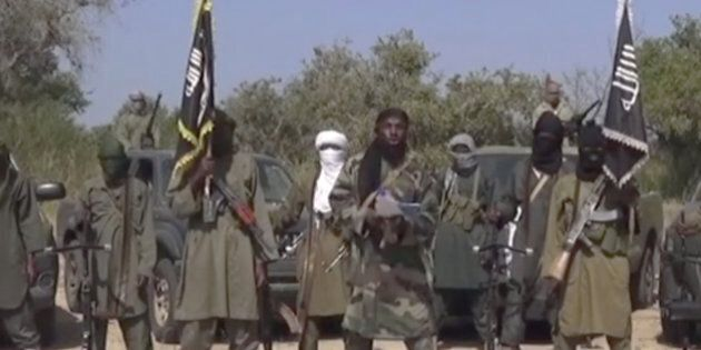 This Friday Oct. 31, 2014 image taken from video by Nigeria's Boko Haram terrorist network, the leader...