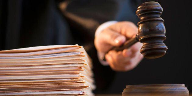 Judge holding gavel,