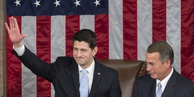 Newly elected Speaker of the House Paul Ryan, Republican of Wisconsin, (L) waves alongside outgoing Speaker...
