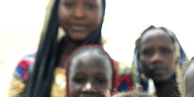 Children of Nigerian refugees stand at a Chadian gendarmerie camp in the village of Klissoum near N'Djamena...