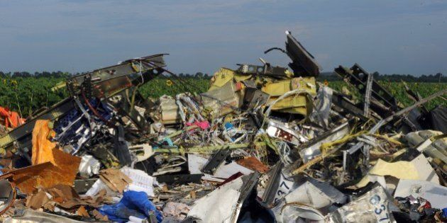 A single shoe is seen on July 19, 2014 at the wreckage of Malaysia Airlines flight MH17 two days after it crashed in a sunflower field near the village of Rassipnoe, in rebel-held eastern Ukraine. Ukraine and pro-Russian insurgents agreed on July 19 to set up a security zone around the crash site of a Malaysian jet whose downing in the rebel-held east has drawn global condemnation of the Kremlin. Outraged world leaders have demanded Russia's immediate cooperation in a prompt and independent probe into the shooting down on July 17 of flight MH17 with 298 people on board.  AFP PHOTO / DOMINIQUE FAGET        (Photo credit should read DOMINIQUE FAGET/AFP/Getty Images)