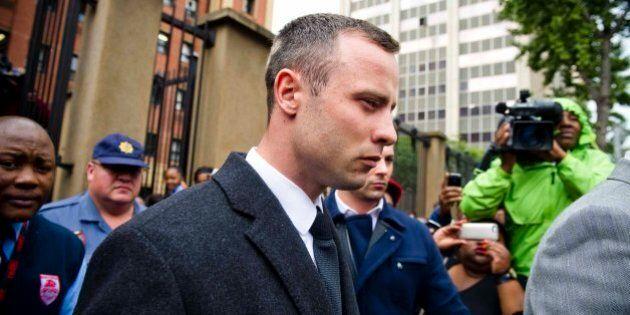 PRETORIA, SOUTH AFRICA - APRIL 14 (SOUTH AFRICA OUT): Oscar Pistorius leaves the Pretoria High Court...
