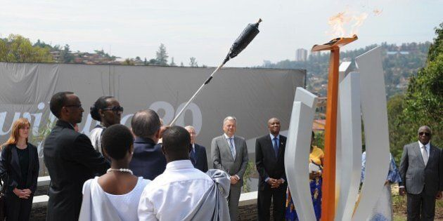 Rwanda's president Paul Kagame (L) and First Lady Janet Kagame light a flame that will burn for 100 days,...