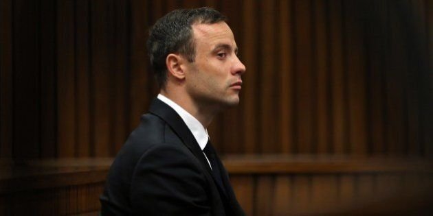 South African Paralympic track star Oscar Pistorius attends his trial in Court in Pretoria on April 7,...