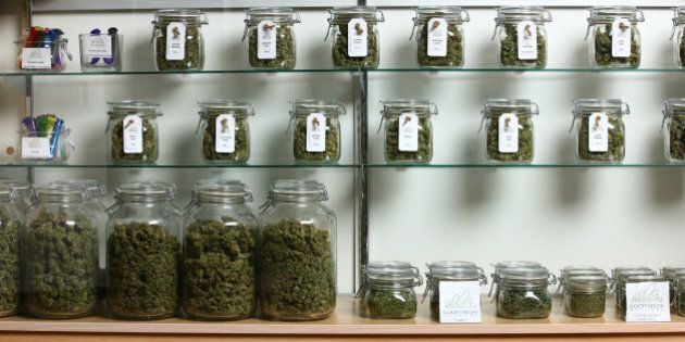 Lakewood, CO - MARCH, 4: Jars of medical cannabis line the shelves inside a Good Meds medical cannabis...