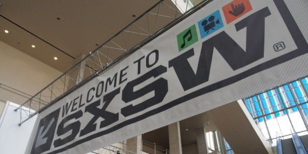 Banners hang in the atrium of the Austin Convention Center on Thursday, March 7, 2012 on the eve of the...
