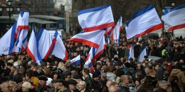 People gather at a pro Russian rally in Simferopol's Lenin Square on March 9, 2014. Ukrainian Prime Minister...