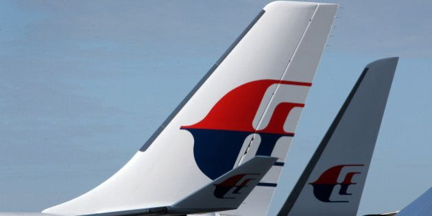 The Malaysian Airline System Bhd. (MAS) logo is displayed on the company's Airbus A330-300 aircraft at...