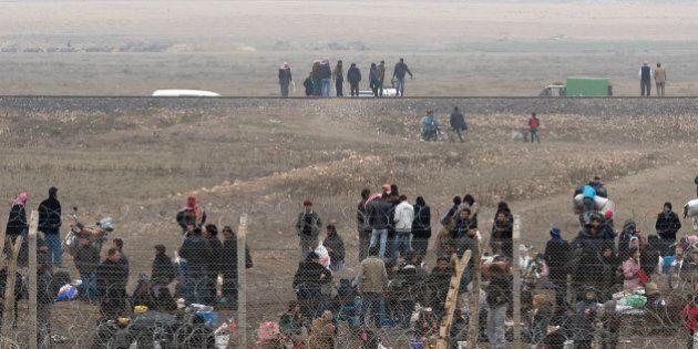 SANLIURFA, TURKEY - JANUARY 23: A Syrian group gather at Syrian side to pass Turkey's side on January...