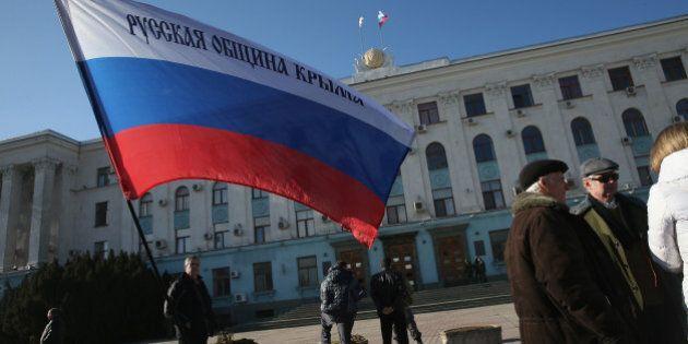 SIMFEROPOL, UKRAINE - MARCH 03: A Russian flag stands outside a local government building where pro-Russian...