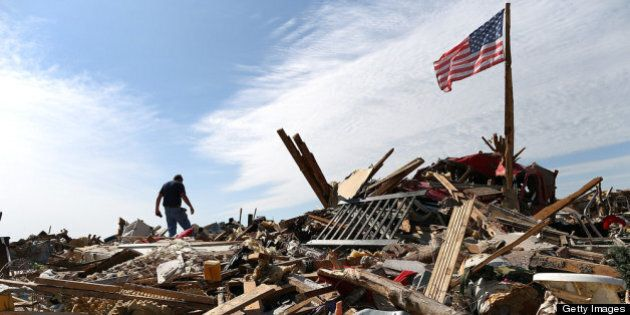 MOORE, OK - MAY 23: Stan Mallette searches through the rubble of his son's home on May 23, 2013 in Moore,...