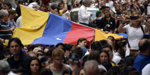 Anti-government demonstrators protest in eastern Caracas on February 27, 2014. Dueling demos of pro-...