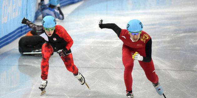 China's Wu Dajing (R) and Canada's Charle Cournoyer compete in the Men's Short Track 500 m Quarterfinals...