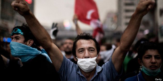 A man flashes a victory sign as people demonstrate in Istanbul on June 4, 2013, during ongoing protests...