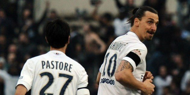 Paris Saint-Germain's Swedish forward Zlatan Ibrahimovic (R) reacts next Paris Saint-Germain's Argentinian...