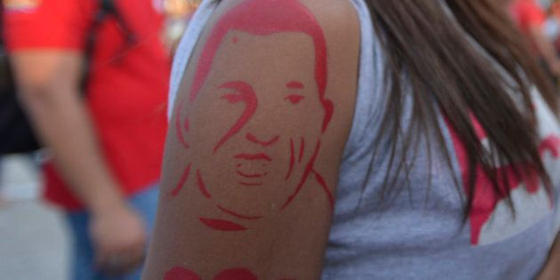 CARACAS, VENEZUELA - MARCH 07: View of a tattoo of a supporter of Chavez in front of the chapel where the body of the dead president remains on March 7, 2013 in Caracas, Venezuela. (Photo by Gregorio Marrero/LatinContent/Getty Images)