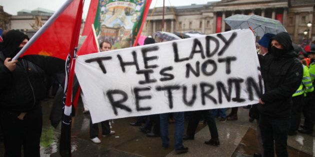 LONDON, ENGLAND - APRIL 13: Protesters hold a sign saying 'The Lady Is Not Returning' during a party...