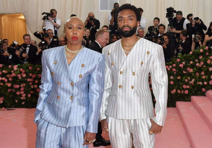 "Lena Waithe attended the 2019 Met Gala wearing a lavender pinstripe suit emblazoned with the words, ""Black drag qu"