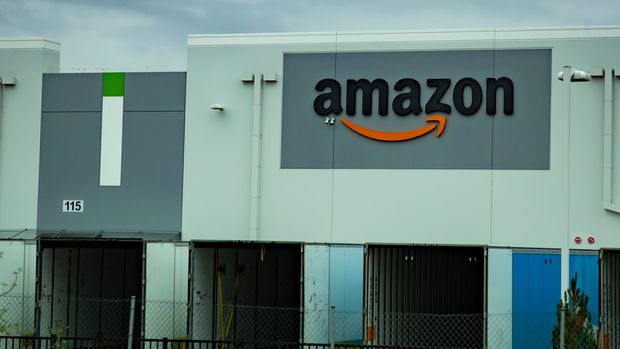 An editorial stock photo of an Amazon warehouse in Eastvale, California
