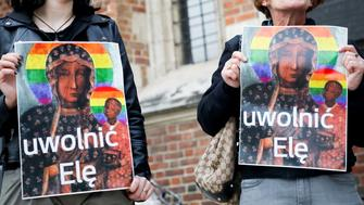 "In this photo taken in Krakow, Poland, May 6, 2019, picketers with posters of Poland's most-revered icon of Mother of God of Czestochowa with the LGBT rainbow colors added to its halos, protest the detention for a few hours of Elzbieta Podlesna, on suspicion she put up such posters near a church in the city of Plock. An inscription on the poster entitled ""Unleash Elzbiete"". (AP Photo/Beata Zawrzel) Poland Out"