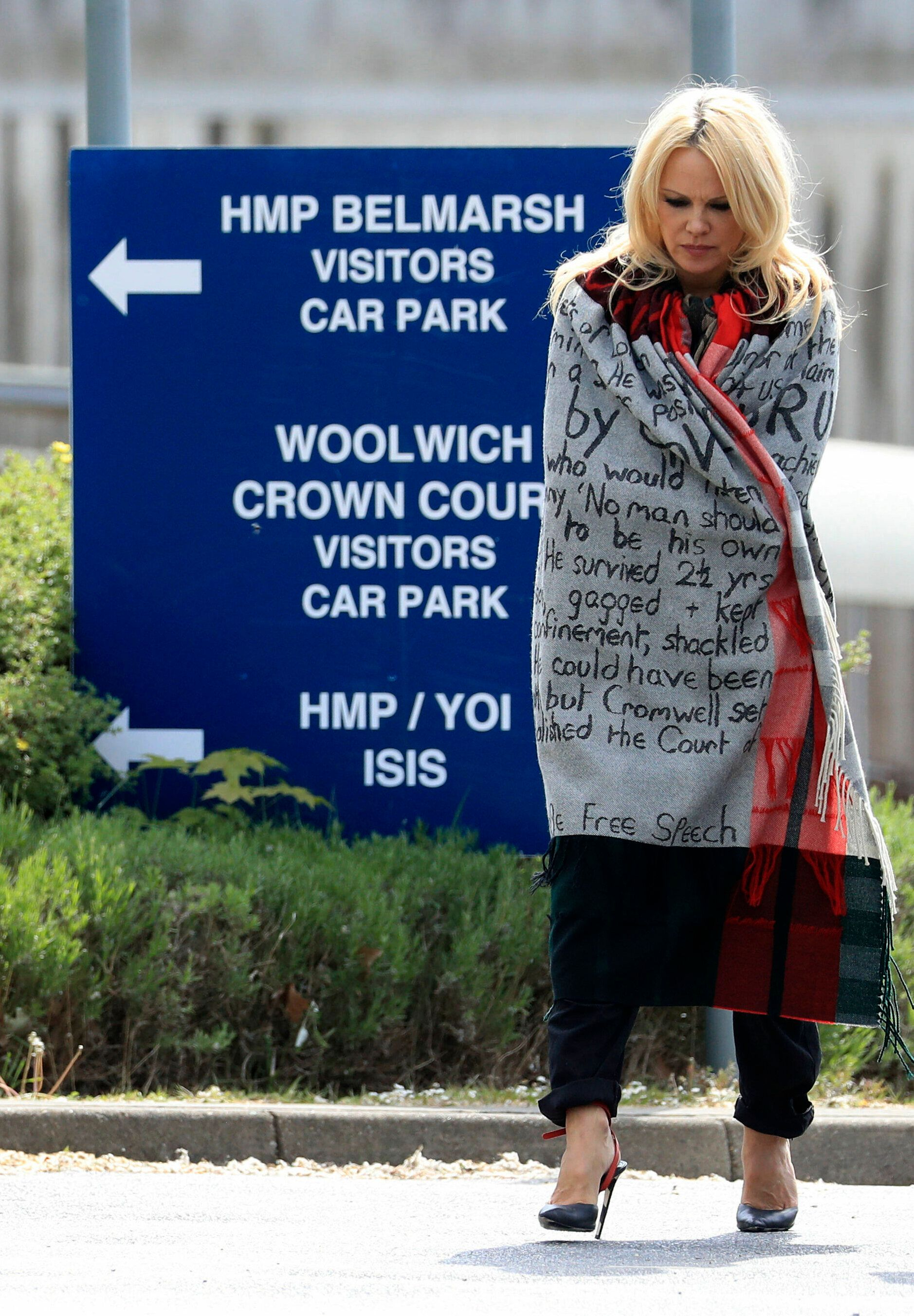 US actress Pamela Anderson leaves Belmarsh Prison in south-east London, after visiting WikiLeaks founder Julian Assange, Tuesday May 7, 2019. (Gareth Fuller/PA via AP)