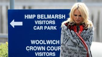 US actress Pamela Anderson leaves Belmarsh Prison in south-east London, after visiting WikiLeaks founder Julian Assange, Tuesday May 7, 2019. (Gareth Fuller/PA via AP)